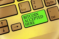 Writing note showing Bitcoin Accepted Here. Business photo showcasing you can purchase things through Cryptocurrencies Keyboard bu. Tton symbol typing job Stock Images