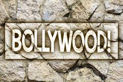Writing note showing Bollywood Motivational Call. Business photo showcasing Hollywood Movie Film Entertainment Cinema Ideas messa. Ge stone stones rock rocks royalty free stock image