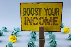 Writing note showing Boost Your Income. Business photo showcasing improve your payment Freelancing Part time job Improve written stock images