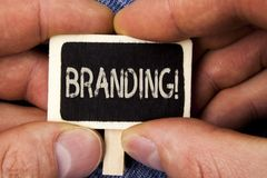 Writing note showing  Branding Motivational Call. Business photo showcasing Creating a unique identity for new startup agencies wr. Itten Wood Piece holding by Royalty Free Stock Photo