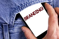 Writing note showing  Branding Motivational Call. Business photo showcasing Creating a unique identity for new startup agencies wr. Itten Mobile phone screen Stock Photo