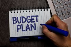 Writing note showing Budget Plan. Business photo showcasing financial schedule for a defined period of time usually year Man holdi royalty free stock photography