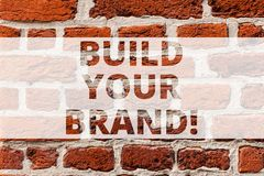 Writing note showing Build Your Brand. Business photo showcasing company creates or improves customers knowledge and. Opinion Brick Wall art like Graffiti stock photos