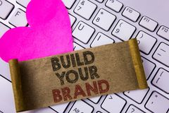 Writing note showing Build Your Brand. Business photo showcasing create your own logo slogan Model Advertising E Marketing writte. N Folded Cardboard Paper Piece royalty free stock images