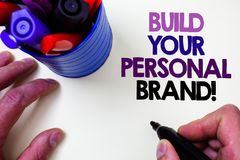 Writing note showing Build Your Personal Brand Motivational Call. Business photo showcasing creating successful company Blue pen. Holder white background shadow royalty free stock images