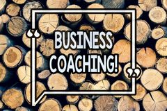 Writing note showing Business Coaching. Business photo showcasing consulting expert your field Experience improvement Wooden. Background vintage wood wild stock photo