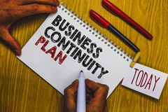 Writing note showing Business Continuity Plan. Business photo showcasing creating systems prevention deal potential threats Man ho. Lding marker notebook royalty free stock photography
