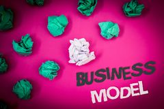 Writing note showing Business Model. Business photo showcasing Innovative Strategic Plan Marketing Vision Successful Ideas Text W. Ords pink background crumbled stock photo