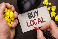 Writing note showing Buy Local. Business photo showcasing Buying Purchase Locally Shop Store Market Buylocal Retailers written by. Man Note Paper Holding Marker royalty free stock images