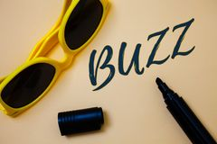 Writing note showing Buzz. Business photo showcasing Hum Murmur Drone Fizz Ring Sibilation Whir Alarm Beep Chime Ideas messages b. Eige background black marker royalty free stock images