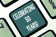 Writing note showing Celebrating 50 Years. Business photo showcasing Golden Anniversary Commemorating a special day. Keyboard key Intention to create computer stock photo