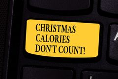 Writing note showing Christmas Calories Don T Count. Business photo showcasing Eat whatever you want in holiday seasons. Keyboard key Intention to create stock photography