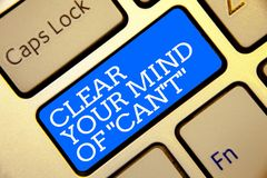 Writing note showing Clear Your Mind Of Can t not. Business photo showcasing Have a positive attitude thinking motivation Golden c. Olor computer keyboard blue Stock Photography