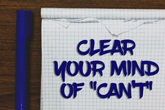 Writing note showing Clear Your Mind Of Can t not. Business photo showcasing Have a positive attitude thinking motivation Written. White notepad on grey wooden royalty free stock image