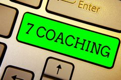Writing note showing 7 Coaching. Business photo showcasing Refers to a number of figures regarding business to be succesful Keyboa. Rd green key Intention royalty free stock photos
