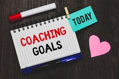 Writing note showing Coaching Goals. Business photo showcasing Empowers individuals Encourages them to take responsibility Open no. Tebook pin holding reminder royalty free stock images