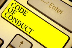 Writing note showing Code Of Conduct. Business photo showcasing Ethics rules moral codes ethical principles values respect Keyboar. D yellow key Intention stock photography