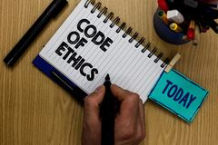 Writing note showing Code Of Ethics. Business photo showcasing Moral Rules Ethical Integrity Honesty Good procedure Man holding ma. Rker notebook clothespin stock photos