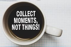 Writing note showing Collect Moments, Not Things. Business photo showcasing Happiness philosophy enjoy simple life facts Coffee mu. G with black coffee floating stock image