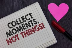 Writing note showing Collect Moments, Not Things. Business photo showcasing Happiness philosophy enjoy simple life facts. Strikethrough words on notepad love stock photos