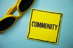 Writing note showing  Community. Business photo showcasing Neighborhood Association State Affiliation Alliance Unity Group Ideas m. Essages blue background Stock Photos