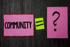 Writing note showing  Community. Business photo showcasing Neighborhood Association State Affiliation Alliance Unity Group Pink no. Tes equal sign question mark Royalty Free Stock Photo