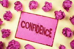 Writing note showing Confidence. Business photo showcasing Never ever doubting your worth, inspire and transform yourself written. Pink Sticky Note Paper plain royalty free stock image