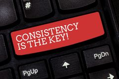 Writing note showing Consistency Is The Key. Business photo showcasing Full Dedication to a Task a habit forming process. Keyboard key Intention to create royalty free stock photography