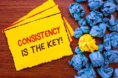 Writing note showing Consistency Is The Key. Business photo showcasing full Dedication to a Task a habit forming process.  royalty free stock images