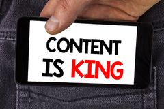 Writing note showing Content Is King. Business photo showcasing articles or posts can guarantee you success Advertising written o. Writing note showing Content stock photos