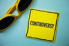 Writing note showing  Controversy. Business photo showcasing Disagreement or Argument about something important to people Ideas me. Ssages blue background Royalty Free Stock Images