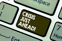 Writing note showing Crisis Just Ahead. Business photo showcasing time of intense difficulty or danger coming soon. Keyboard key Intention to create computer royalty free illustration