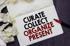 Writing note showing Curate Collect Organize Present. Business photo showcasing Pulling out Organization Curation Presenting Marke. R over notebook crumpled stock photos