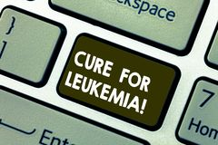 Writing note showing Cure For Leukemia. Business photo showcasing transplantation high doses of chemotherapy or. Radiation Keyboard key Intention to create royalty free stock photo