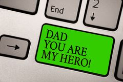 Writing note showing Dad You Are My Hero. Business photo showcasing Admiration for your father love feelings compliment Silver gre. Y computer keyboard green royalty free stock image