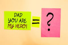 Writing note showing Dad You Are My Hero. Business photo showcasing Admiration for your father love feelings compliment. Written on green sticky note on yellow royalty free stock photos