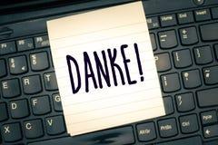 Writing note showing Danke. Business photo showcasing used as informal way of saying thank you in German language. Thanking royalty free stock photos