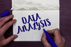 Writing note showing Data Analysts. Business photo showcasing Programmer Design and Create Report Identifies patterns Man holding. Marker notebook page crumpled stock photo