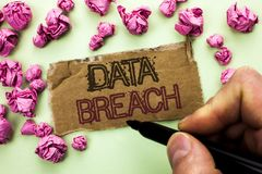 Writing note showing  Data Breach. Business photo showcasing Stolen Cybercrime Information Hacking Security Malicious Crack writte. N by Man Holding Marker Tear Royalty Free Stock Image