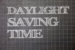 Writing note showing  Daylight Sayving Time. Business photo showcasing advancing clocks during summer to save electricity Graph pa. Per grey messages thoughts Stock Photo