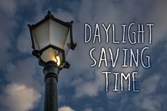 Writing note showing  Daylight Sayving Time. Business photo showcasing advancing clocks during summer to save electricity Light po. St cloudy enlighten message Stock Image