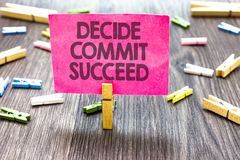 Writing note showing Decide Commit Succeed. Business photo showcasing achieving goal comes in three steps Reach your dreams Multip. Le clips woody table small royalty free stock image