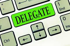 Writing note showing Delegate. Business photo showcasing demonstrating sent or authorized represent others particular. Conference stock image