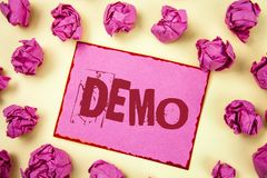 Writing note showing  Demo. Business photo showcasing Demonstration of products by software companies are displayed annually writt. En Pink Sticky Note Paper Stock Images