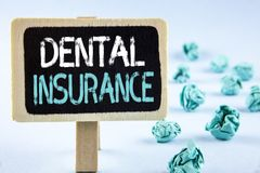 Writing note showing  Dental Insurance. Business photo showcasing Dentist healthcare provision coverage plans claims benefit writt. En Wooden Notice Board plain Royalty Free Stock Image