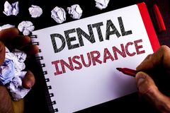 Writing note showing  Dental Insurance. Business photo showcasing Dentist healthcare provision coverage plans claims benefit writt. En by Man Notepad holding Stock Image