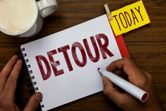 Writing note showing Detour. Business photo showcasing long or roundabout route taken to avoid something or visit. Somewhere Man holding marker notebook pin stock photo