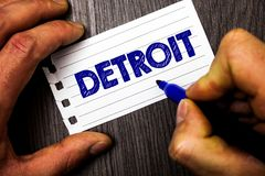 Writing note showing Detroit. Business photo showcasing City in the United States of America Capital of Michigan Motown Man hold. Holding marker notebook paper royalty free stock photo