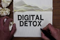 Writing note showing Digital Detox. Business photo showcasing Free of Electronic Devices Disconnect to Reconnect Unplugged Man hol. Ding marker notebook crumpled stock images