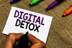 Writing note showing Digital Detox. Business photo showcasing Free of Electronic Devices Disconnect to Reconnect Unplugged Man han. D holding marker white paper stock photo